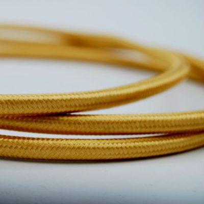 een afbeelding van het goudkleurige textielsnoer van die-saain