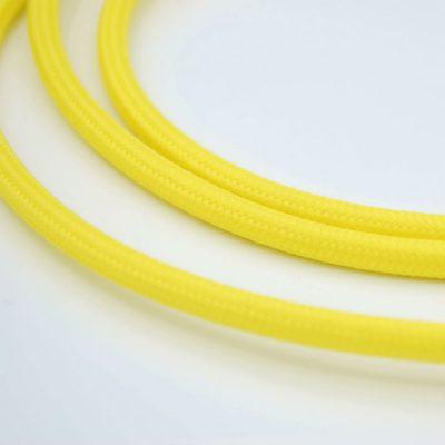 Een afbeelding van een geel textielsnoer