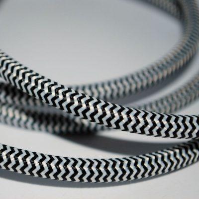 Een afbeelding van een zwart wit visgraat textielsnoer