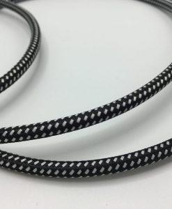 Een foto van een textielsnoer met zwart witte streep
